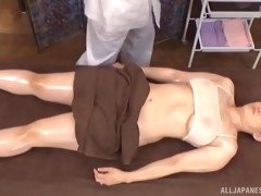 masseur allows his sexy japanese customer to ride his erected dick