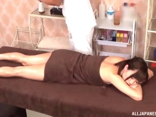 asian babe lets the guy to spice up the massage with pussy rubbing